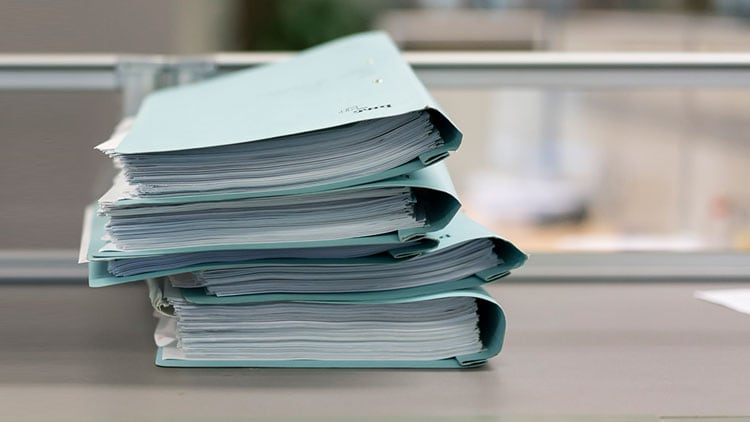 Stack of light blue reports